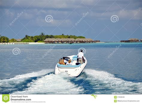speed boat in maldives speed boat and tourists in the maldives editorial photo