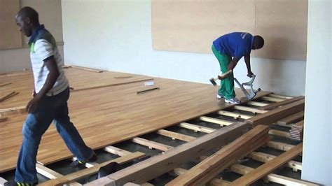 a suntups wooden floor being installed in a gym in south africa youtube