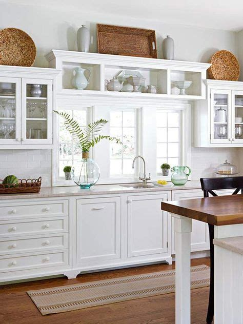 what to put in kitchen cabinets what to put above kitchen cabinets at home design concept