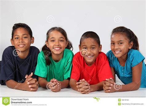 Two Eleven Child friendship of four happy ethnic school children stock