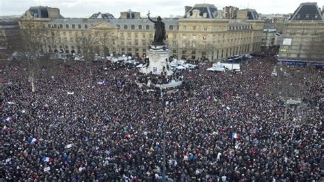 charlie hebdo attacks paris rally as it happened 11 watch crowd at paris rally sing john lennon s quot imagine