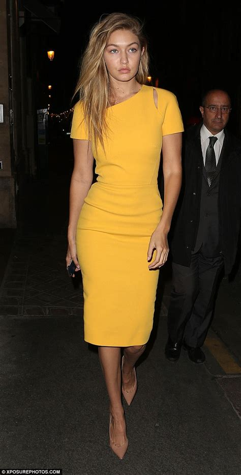 Gigi Hadid Dress Gigi Hadid Parades Figure In Yellow Dress As She Steps