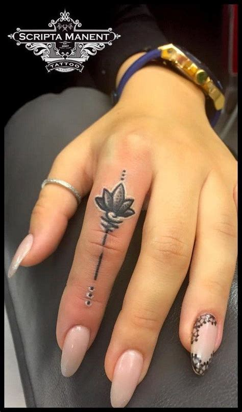 lotus finger tattoo best 25 tattoos for ideas on