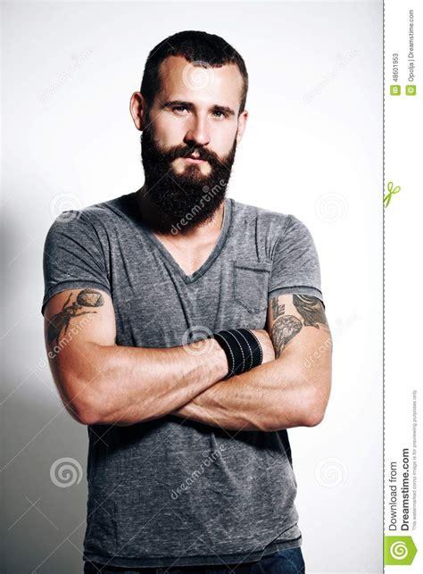 tattooed brutal man stock photo image