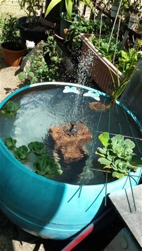 completely recycled plastic drum fish pond  solar