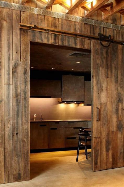 A Kitchen Behind A Sliding Barn Door My Style Barn Door For Kitchen