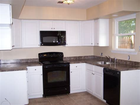 black kitchen cabinets with white appliances want to step up your all white kitchen with black