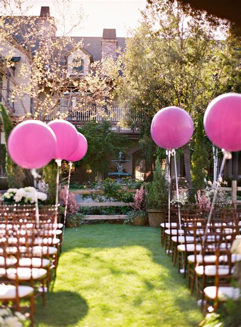 wedding aisle balloons and creative ways to use balloons on your wedding day