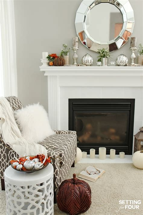 winter mantel decorating ideas setting for four fall mantel decor using fall flowers and foliage setting