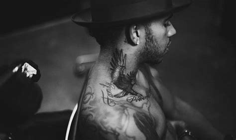 lewis hamilton proudly displays large new eagle tattoo and