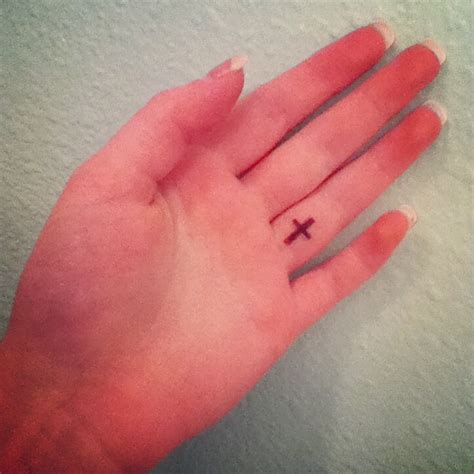 god tattoo on finger small cross tattoo perfect placing on the left ring finger