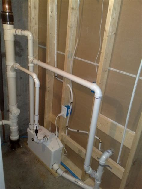 toilet with pump for basement upflush or a sewage ejector