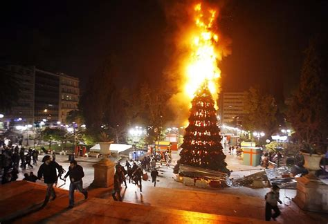 christmas tree torched in athens riots