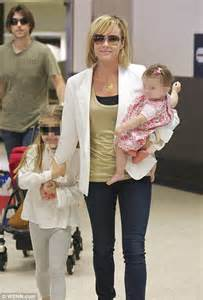 amanda holden and family amanda holden cuddles up to as she flies into