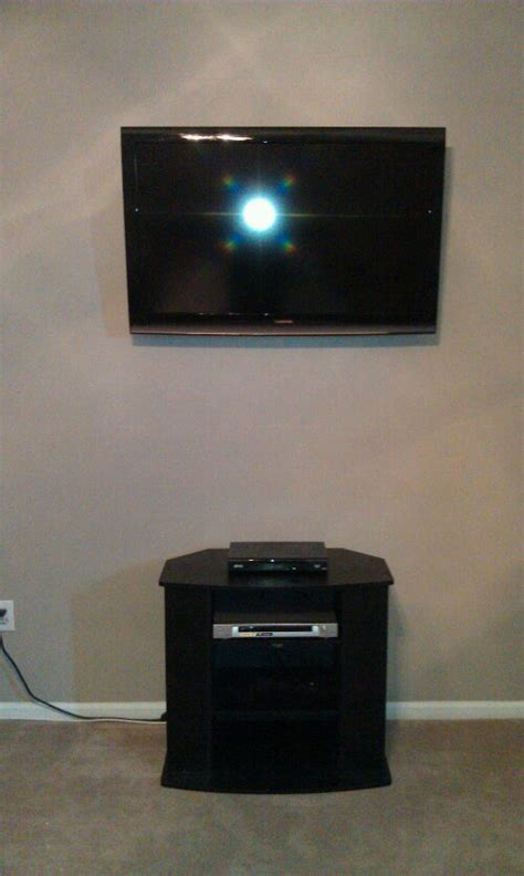 cabinet for dvd player and cable box tv on wall with wires concealed components in cabinet