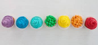 rainbow cake and cupcakes decorated with birthday candles rainbow cake and cupcakes decorated with birthday candles stock image image of candle stripes
