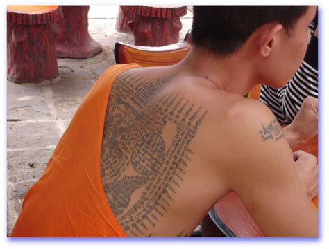 monk tattoos thai tradition of tattooing sak yant sirinya s thailand