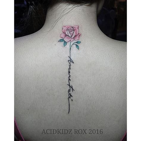 rose tattoo spine tattoo pinterest rose tattoos