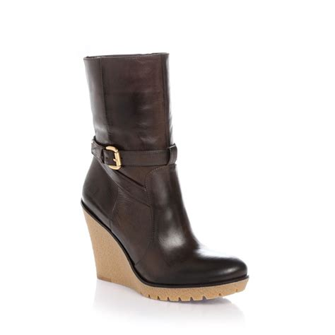 guess wedge boots in brown brown lyst