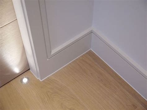 modern interior trim continuous reveal detail at door casing and baseboard