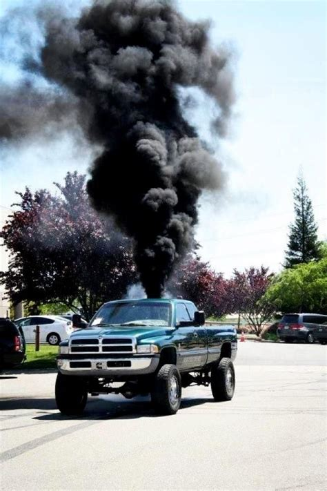 My goodness... I just love a diesel truck. Hearing that ... Lifted Duramax Diesel Blowing Smoke