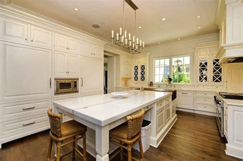 white kitchen marble island hooked on houses