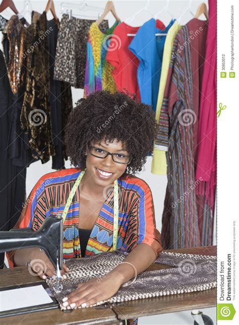 african american sewing blogs portrait of an african american female tailor stitching