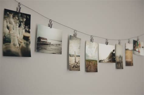 hanging pictures with wire and clips photography prints hanging from clips on a wire photos