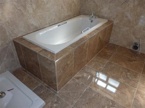 how to tile the bathroom boxing in tiling around a bath