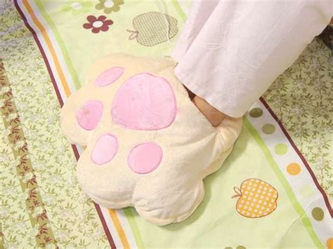 Paw Warmer paw shaped foot warmers keep your toes toasty with heated