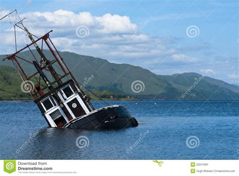 boat sinking in your dream partially submerged fishing vessel in loch linnie stock