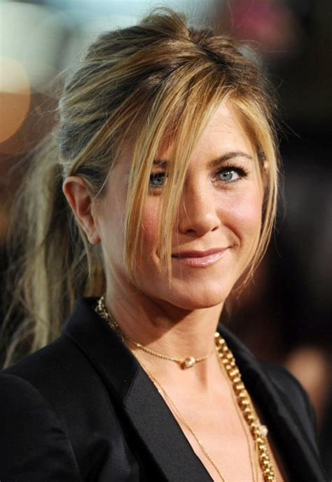 jennifer aniston steps out with new blond bangs while jennifer aniston s 9 best hair looks styleicons