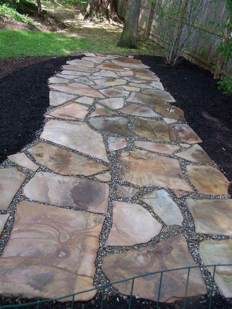 irregular natural stone permeable patio  pea gravel