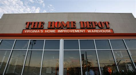 home depot tops estimates raises outlook