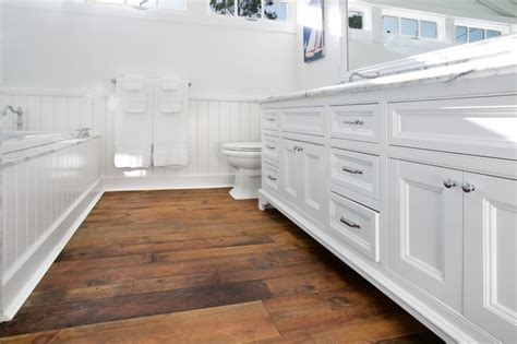 wood floor in bathroom white beach house beach style bathroom orange county