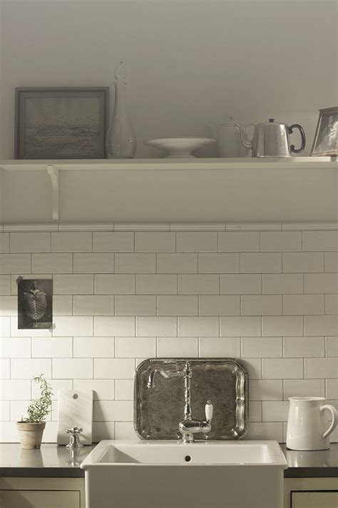 cream cabinets white subway tiles grey cement