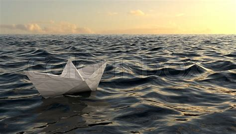 origami boat on water origami paper boat sailing on blue water stock photo