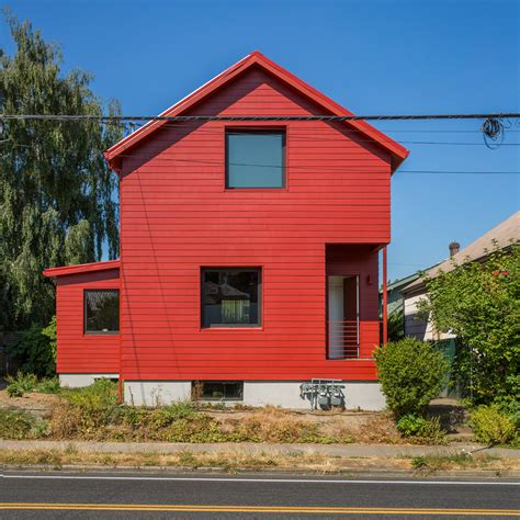 red house design waechter architecture updates century old portland house with a bright red facade