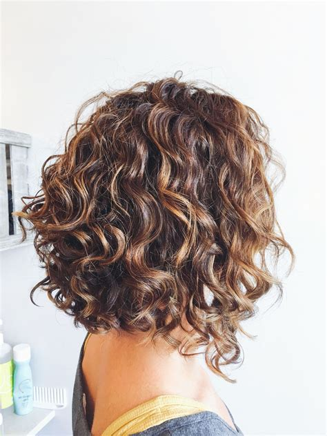 curly bob with shorter layers on top around face i like the layers at the back and the angle down to the