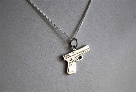 custom made gun charm by chris alix jewelry inc