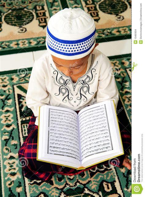 a muslim boy books muslim reading koran stock images image 13481604