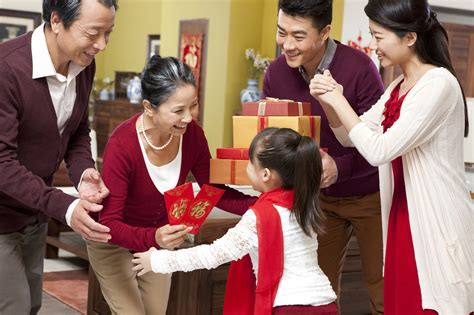 new year traditions giving money how much ang pow money is enough insuranceguru sg