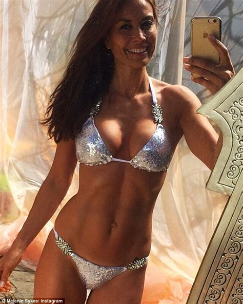 Still got it melanie sykes 46 shows off her washboard abs and ample