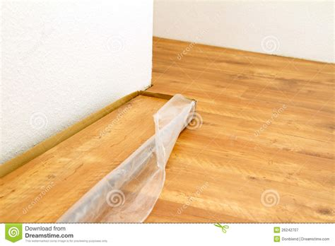 Laying Flooring by Laying Wooden Flooring Royalty Free Stock Photography
