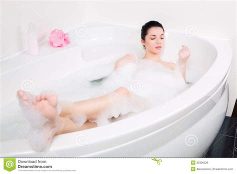 women in the bathtub beautiful young woman takes bubble bath royalty free stock