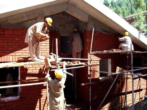 construction of a house free picture building house building construction workers