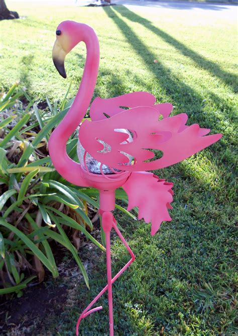 pink flamingo lawn ornament with solar light decoration