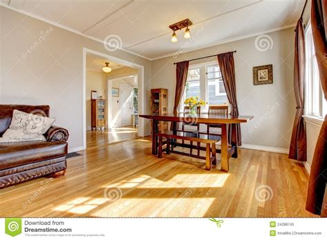 Dining Room Floor Ls by Dining Room With Brown Curtain And Hardwood Floor Stock