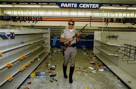 chp officer hugh gnecco checks for looters in a chief auto