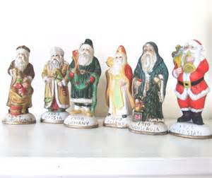 6 porcelain figurines santas from around the world